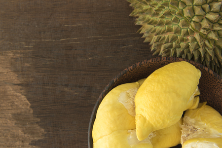 dissect: Durian fruit ripening in the bowl on the table. Stock Photo