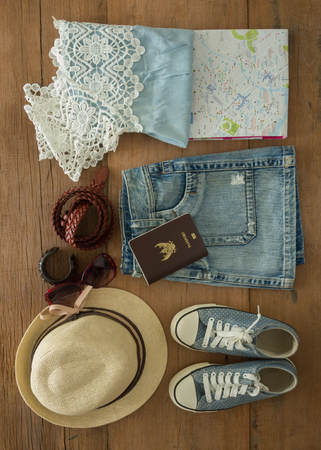 composed: Outfit of traveler, student, teenager, young woman. Top view of clothing and accessory for women.
