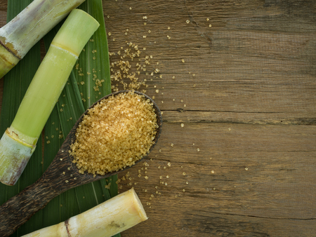 granulated brown sugar produced from sugar cane. Agriculture Industry concept