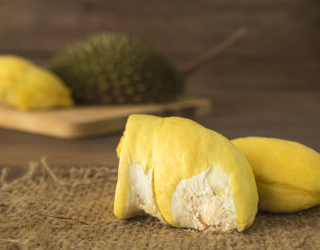 dissect: Durian fruit ripening on a sack on the table. Stock Photo