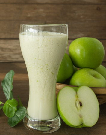 flavorful: green apple juice in glass on wooden background Stock Photo