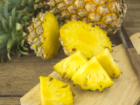 pineapple and pineapple slice on wood table. for health. Stock Photo