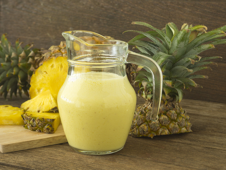 pineapple juice: pineapple juice and pineapple slice on wood table. for health.