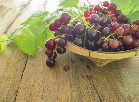 red grape: Bunch of grapes on a wooden table.