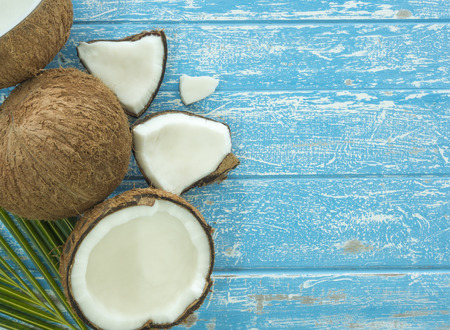 Fresh coconut and coconut sliced on a wooden table. Stock Photo