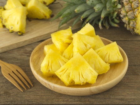 pineapple: pineapple and pineapple slice on wood table. for health. Stock Photo