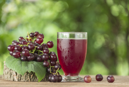 Grape juice in a glass on the table.