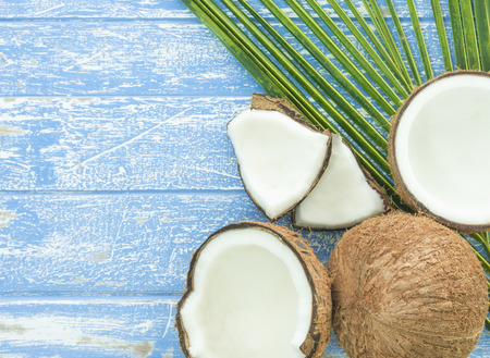 Fresh coconut and coconut sliced on a wooden table. Standard-Bild