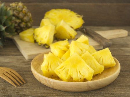 pineapple and pineapple slice on wood table. for health. Foto de archivo