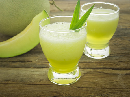 Delicious juice of melon on table close-up Imagens