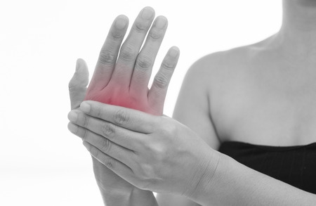 Front view of a young women hand muscle pain. Red around the pain area. Stock Photo