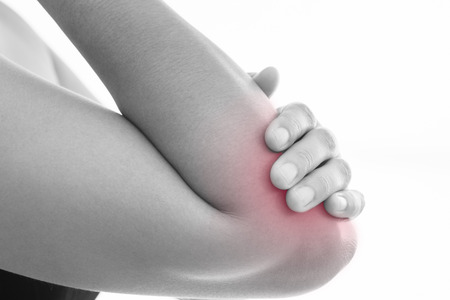 calf strain: Lateral view of a young women elbow muscle pain. Red around the pain area