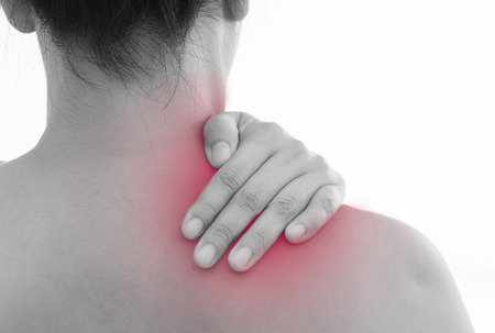 Rear view of a young women shoulder muscle pain. Red around the pain area.