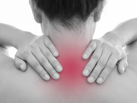 Rear view of a young women neck and back muscle pain. Red around the pain area.