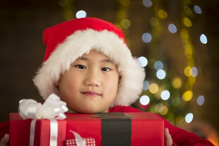 santa cross: Children are a gift received from Santa Cross. - Christmas day concept. Soft focus.