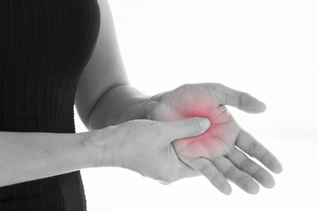 calf strain: Front view of a young women hand (palm)  muscle pain. Red around the pain area.