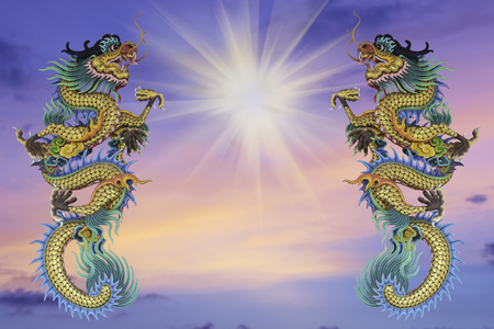 symbolics: Chinese style dragon statue, blurred background evening before sunset.. - can be used for display your products or promotional and advertising posters. Stock Photo