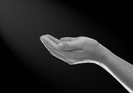 forgiven: The color scheme of black and white hands in prayer.