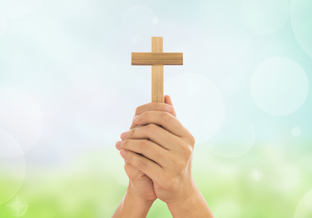 revelation: Human hands holding a cross holy and prayed for blessings from God.