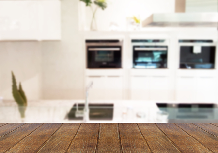 expensive granite: Wood table top on blur the background of the kitchen.