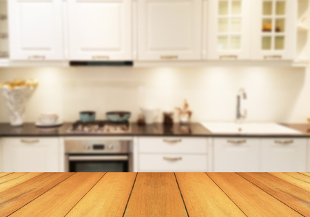 expensive granite: Wood table top on blur the background of the kitchen. - can be used for display your products or promotional and advertising posters