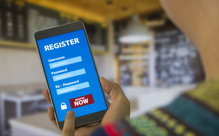 Register Membership Application on mobile smartphone against the background blurred cafe, Business Concept. soft focus. Stock Photo