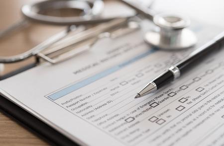 historia clinica: closeup pen on medical record application form. medical concept.