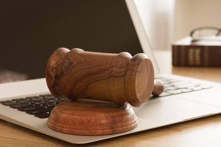 information technology law: Gavel on keyboard laptop computer. Concept of online auction.