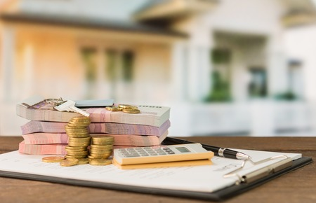 loans: loan money with loans document. concept of mortgage, mortgage loans,credit for housing. soft focus.