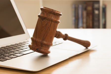 Gavel on keyboard laptop computer. Concept of Online auction.