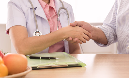 reassuring: Doctors nutritionists handshake on the patient to  reassuring. Stock Photo