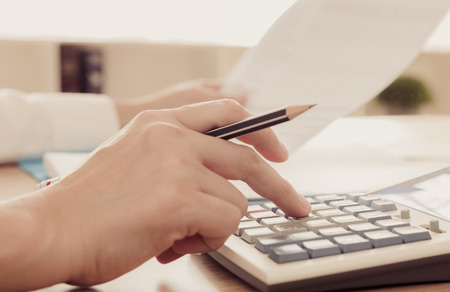 calculated: entrepreneur calculation and reviewing investment plan. concept of accounts, calculated, planning.