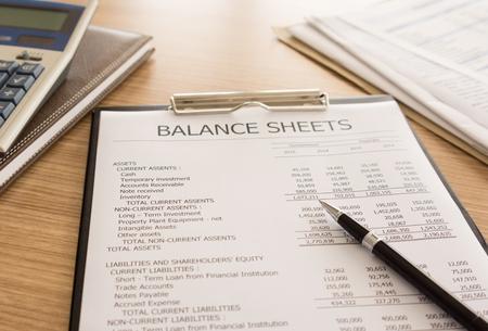 stockholder: closeup pen place on the balance sheet on desks accountant. Stock Photo