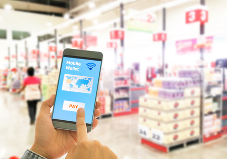 Digital wallet to pay for goods and services in a superstore for easy and fast. Stock Photo