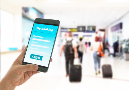 Using mobile smart phone booking hotle before a trip. Technology Concept.
