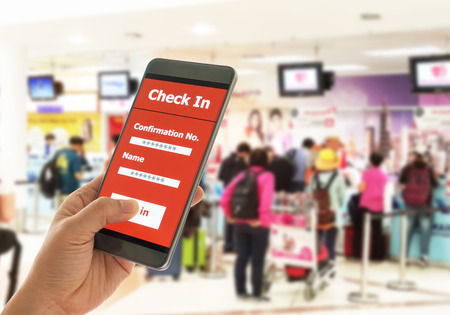 Using mobile smart phone Check In Airport Flight. Traveling Concept Stock Photo