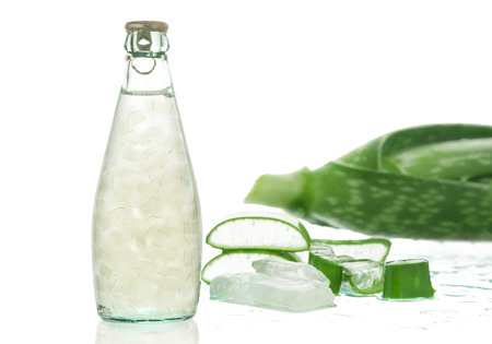 free radicals: Aloe vera juice in glass isolated on white background. Can help neutralize free radicals Contributes to aging. And help strengthen the immune system as well. Stock Photo