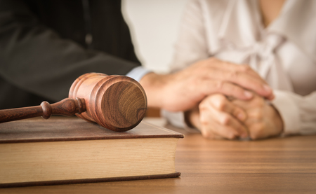 Gavel ,law books with attorneys provide legal advice and consoling to his clients in background. Divorce law ,Legal advice, Family law concept. Standard-Bild