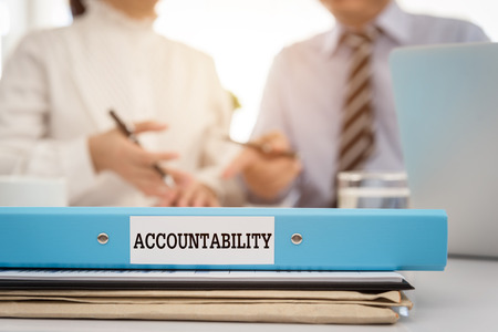 account executive: Accountability document file put on the table in the meeting room. Stock Photo