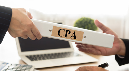 cpa: Certified public accountant (CPA) folder with Control Board Auditing Practices.