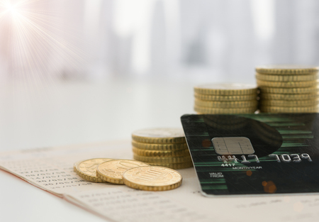 capital gains: Credit card with coins pile on passbook bank. Concepts of finance, financial, credit,  personal loans,banking and finance. Stock Photo