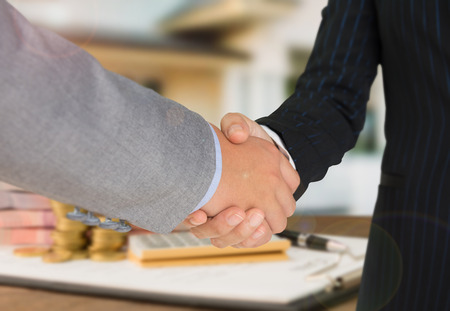 Bank employees handshake with business people for congratulate. Concept mortgage loan approval.