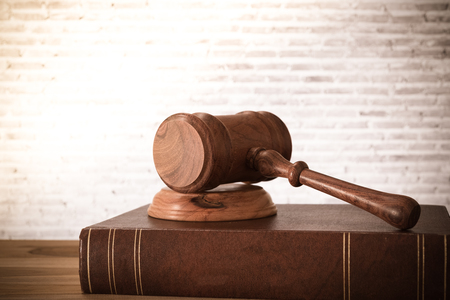 Closeup wooden judges gavel on wooden table with legal books. retro style. Concept of Law, Legal, Legal Books. Stock Photo