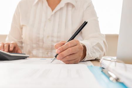 Auditor or internal revenue service staff checking annual financial statements of company. Concept of Audit , Planning budget. Stock Photo