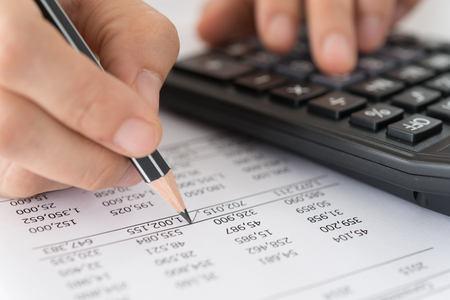 Accountants verify the accuracy of financial statements. Accounting Concept. Stock Photo