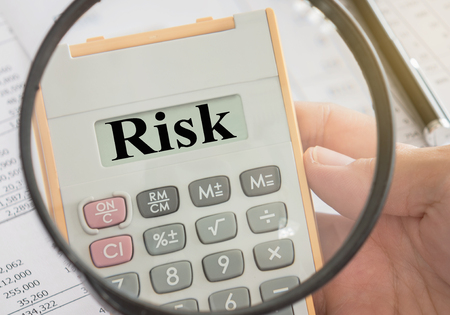 Risk word in calculator and magnifier. concepts of risk management, risk assessment. Stock Photo