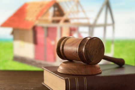 building regulations: gavel judge on law books. construction law. Stock Photo