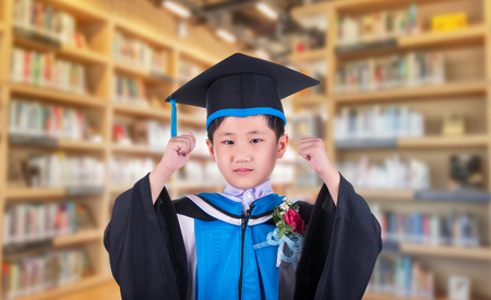 Education concept, Child wears a frilly expressed his delight at the success to education and background libraries.