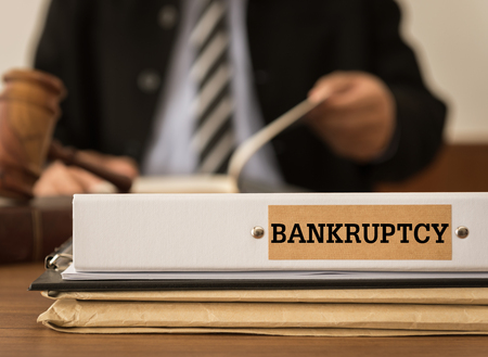 Bankruptcy document folder with lawyer work at law firm. concept of bankruptcy law,