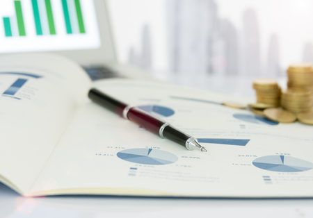 Close-up pen on financial report. Concept of Financial, Data Analysis, Investment Planning, Business Analytics.
